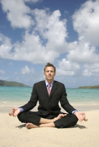 man-doing-yoga-in-business-suit-on-beach1.jpg